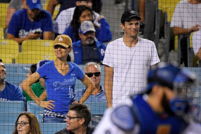 Actors Mila Kunis, left, and Ashton Kutcher watch during a baseball game between the Los Angeles Dodgers and the Colorado Rockies Saturday, Sept. 21, 2019, in Los Angeles. (AP Photo/Mark J. Terrill)