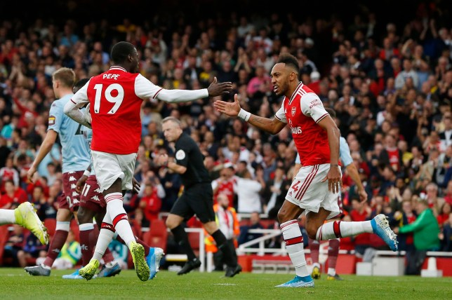epa07862018 Arsenal's Nicolas Pepe (L) is congratulated by Arsenal's Pierre-Emerick Aubameyang after he scored during the English Premier League soccer match between Arsenal FC and Aston Villa at the Emirates Stadium in London, Britain, 22 September 2019. EPA/HOLLIE ADAMS EDITORIAL USE ONLY. No use with unauthorized audio, video, data, fixture lists, club/league logos or 'live' services. Online in-match use limited to 120 images, no video emulation. No use in betting, games or single club/league/player publications.