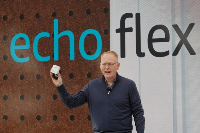 Dave Limp, senior vice president for Amazon devices & services, holds a new Echo Flex device as he speaks Wednesday, Sept. 25, 2019, at an event in Seattle to unveil new products that work with the company's Alexa smart devices line. (AP Photo/Ted S. Warren)