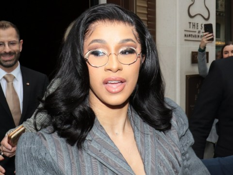 Cardi B cuts a demure figure at Paris Fashion Week in 'teacher' outfit and we are ready for class