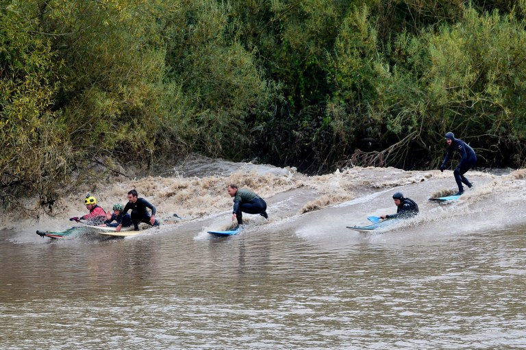 Hundreds of spectators line the banks of the river Severn in Gloucestershire to watch surfers and kayakers riding a 4 star bore, September 30 2019. Bores are rated up to five and reach their highest peaks due to many factors including when the moon is closest overhead.
