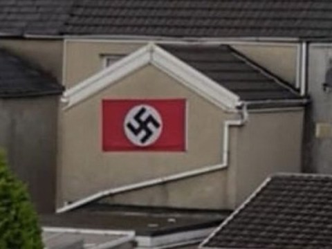 Man who displayed huge swastika flag on home will face no further action