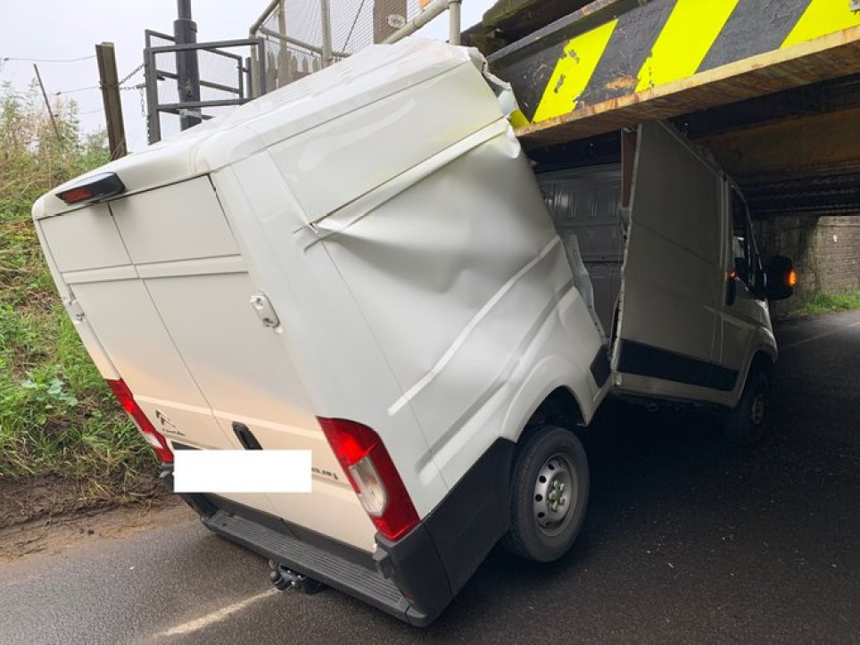 The van was split in two as it headed under the bridge (Picture: SWNS)