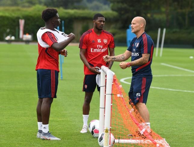 Freddie Ljungberg issues instructions to Bukayo Saka and Ainsley Maitland-Niles during Arsenal training