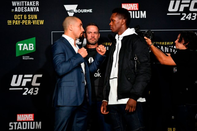 MELBOURNE, AUSTRALIA - OCTOBER 04: (L-R) UFC middleweight champion Robert Whittaker of New Zealand and UFC interim middleweight champion Israel Adesanya of New Zealand face off for the media during UFC 243 Ultimate Media Day at Marvel Stadium on October 4, 2019 in Melbourne, Australia. (Photo by Jeff Bottari/Zuffa LLC/Zuffa LLC via Getty Images)