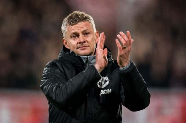 Ole Gunnar Solskjaer applauds Manchester United fans after a match
