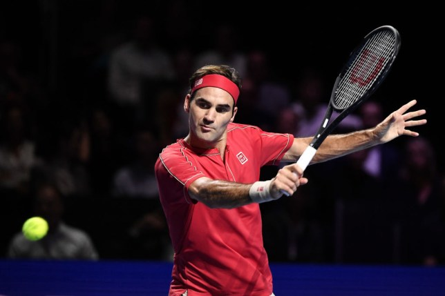 Roger Federer hits a backhand at the Swiss Indoors ATP event in Basel