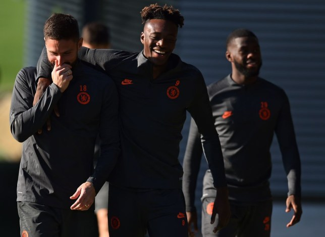 Chelsea's French striker Olivier Giroud (L), Chelsea's English striker Tammy Abraham (C) and Chelsea's Canadian-born English defender Fikayo Tomori attend a training session at Chelsea's Cobham training facility in Stoke D'Abernon, southwest of London on October 22, 2019, on the eve of their UEFA Champions League Group H football match against Ajax. (Photo by Glyn KIRK / AFP) (Photo by GLYN KIRK/AFP via Getty Images)