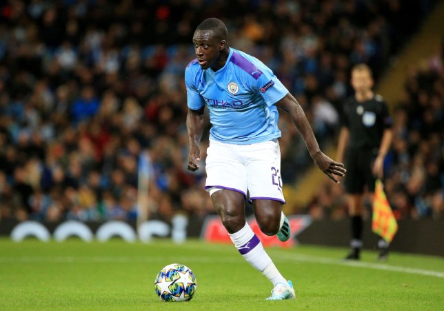 Benjamin Mendy dribbles with the ball during Manchester City's game against Dinamo Zagreb