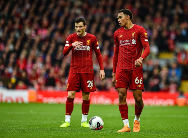 Trent Alexander-Arnold and Andrew Robertson stand over a free-kick during Liverpool's game against Leicester