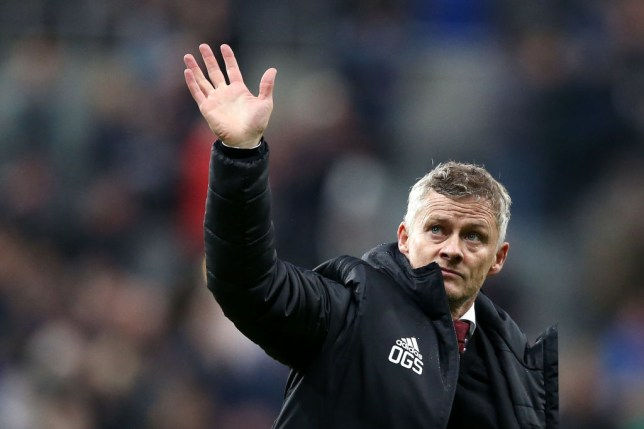 Ole Gunnar Solskjaer waves to Manchester United fans after a match