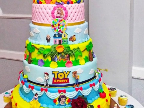 Couple have three foot tall Disney themed cake at their wedding