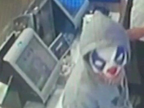Moment police Taser knife wielding robber wearing clown mask in McDonald's