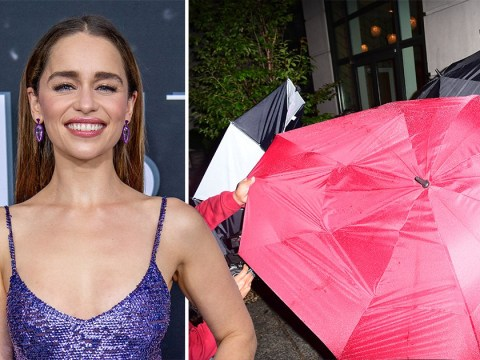 Emilia Clarke being shielded from the rain by at least four umbrellas is our mood all winter