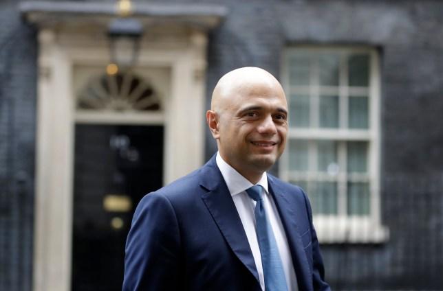 Britain's Chancellor Sajid Javid walks across Downing Street in London, Thursday, Sept. 26, 2019. (AP Photo/Kirsty Wigglesworth)