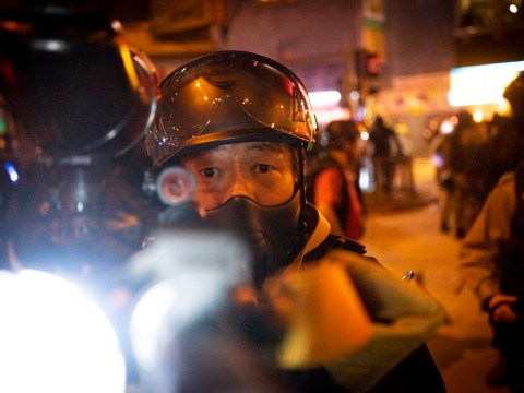Looking down the barrel of a gun: Photographer threatened at Hong Kong protest