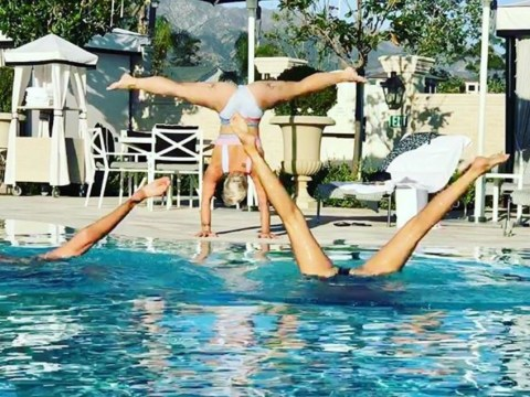 Pink shows off as she aces poolside handstand with splits on post-tour holiday
