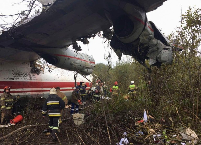 epa07894745 A handout photo made available by Ukraine's State Emergency Service shows the damaged Antonov An-12 military aircraft after its emergency landing in Lviv region, western Ukraine, 04 October 2019. On 04 October 2019 morning, the An-12 transport aircraft had disappeared from radar when approaching Danylo Halytskyi International Airport Lviv at a distance of 13.7 km and was found in 1,5 km distance from runway. According to Ukrainian officials, five people were dead and three injured. EPA/UKRAINE'S STATE EMERGENCY SERVICE / HANDOUT HANDOUT EDITORIAL USE ONLY/NO SALES