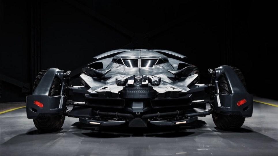 """Pic shows: Real """"Batmobile"""" with a gun and an tank engine for sale in Russia This stunning 20-foot driveable recreation of the batmobile- complete with a thermal imager and ???gun??? on the bonnet - has been put up for sale in Russia."""