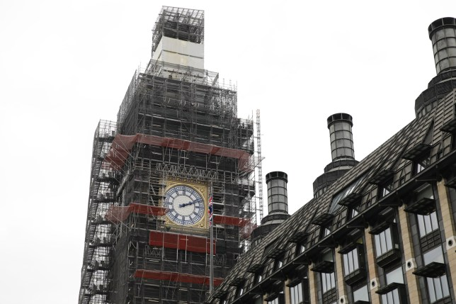 Workers stand on the scaffolding in front of the newly revealed restored north dial of the clock on Elizabeth Tower, commonly known by the name of the bell Big Ben, at the Palace of Westminster, home to the Houses of Parliament, in London on March 21, 2019. - The north dial of the famous clock was revealed after undergoing repairs as part of the Elizabeth Tower conservation project that has seen the whole tower covered in scaffolding and silenced for months. (Photo by Tolga AKMEN / AFP) (Photo credit should read TOLGA AKMEN/AFP/Getty Images)