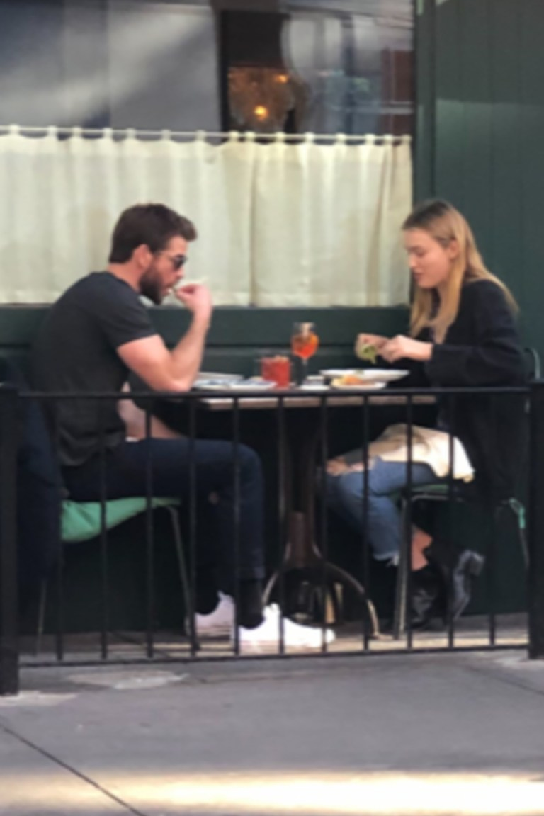 """BGUK_1750015 - *PREMIUM-EXCLUSIVE* ** RIGHTS: ONLY UNITED KINGDOM ** New York, NY - MUST CALL FOR PRICING BEFORE USAGE - The girl strolling the streets with Liam is Australian actress Maddison Brown ... a star on the CW show """"Dynasty."""" Liam Hemsworth's showing the best way to get over an ex -- especially when she's moved on twice already -- is to move on yourself ... with another hot blonde. Liam was spotted in NYC's West Village neighborhood Thursday holding hands with a mystery woman ... both of them rocking jackets and sunglasses. The two enjoyed a meal and some drinks together at Sant Ambroeus ... before going on a romantic stroll. Can't say Liam's date's a total Miley Cyrus look-alike ... but the similarities are there. Hemsworth's stepping out with a new chick ... more subtle than Miley flaunting her fling with Australian singer Cody Simpson. As we've reported ... Liam showed off his guns earlier this week while filming a new TV series in Canada, on the heels of Miley making out with her new man and showing off his bod on social media. Simpson also played the role of Cyrus' hunky home nurse after she got out of the hospital for tonsillitis ... helping her recover from surgery. As you know ... Liam and Miley split in August and he filed for divorce shortly afterward. The breakup got pretty nasty, but it seems like they're both back on their feet. So ... let their back-and-forth games continue. **MANDATORY CREDIT: TMZ/BACKGRID** Pictured: Liam Hemsworth, Maddison Brown BACKGRID UK 11 OCTOBER 2019 BYLINE MUST READ: TMZ / BACKGRID UK: +44 208 344 2007 / uksales@backgrid.com USA: +1 310 798 9111 / usasales@backgrid.com *UK Clients - Pictures Containing Children Please Pixelate Face Prior To Publication*"""