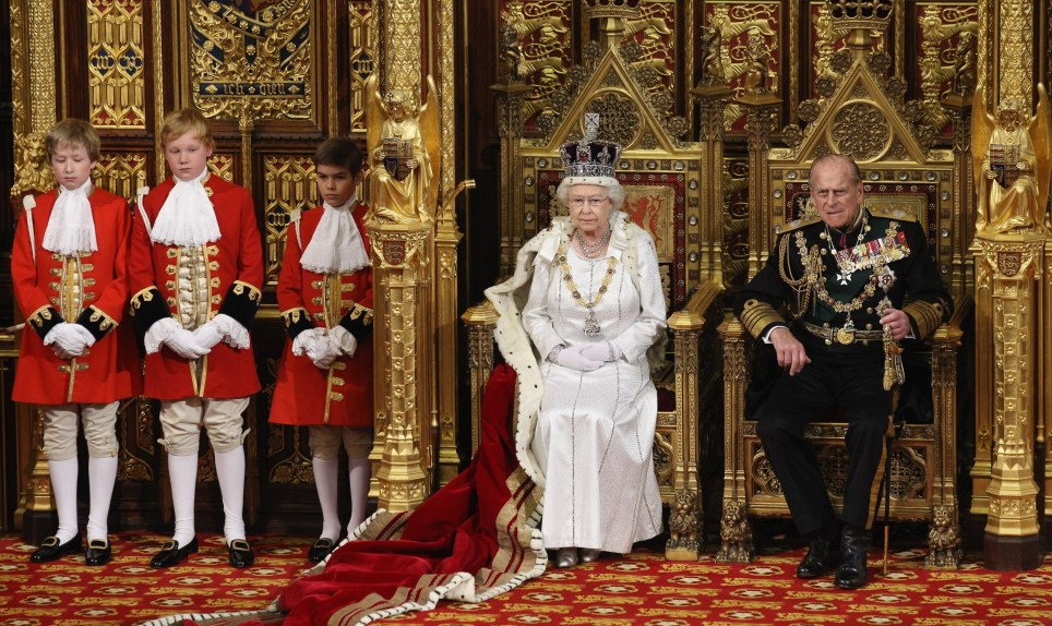 LONDON, ENGLAND - MAY 09: Queen Elizabeth II, accompained by Prince Philip, the Duke of Edinburgh, prepares to deliver her speech in the House of Lords during the State Opening of Parliament on May 9, 2012 in London, England. Queen Elizabeth II unveiled the coalition government's legislative programme in a speech delivered to Members of Parliament and Peers in The House of Lords. New legislation is expected to be introduced on banking reform, House of Lords reform, changes to public sector pensions and plans for increased internet monitoring. (Photo by Oli Scarff - WPA Pool/Getty Images)
