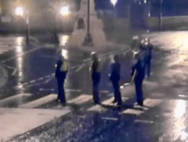 CCTV catches police posing for The Beatles' Abbey Road picture at 2.30am