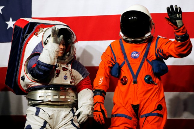 Advanced Space Suit Engineer at NASA Kristine Davis wears the xEMU prototype space suit next to lead engineer Dustin Gohmert wearing the Orion crew survival spacesuit prototype for the next astronaut to the moon by 2024, during its presentation at NASA headquarters in Washington, U.S., October 15, 2019. REUTERS/Carlos Jasso
