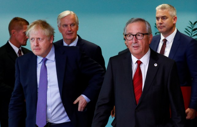 European Commission President Jean-Claude Juncker and Britain's Prime Minister Boris Johnson arrive for a news conference after agreeing on the Brexit deal, at the sidelines of the European Union leaders summit, in Brussels, Belgium October 17, 2019. REUTERS/Francois Lenoir