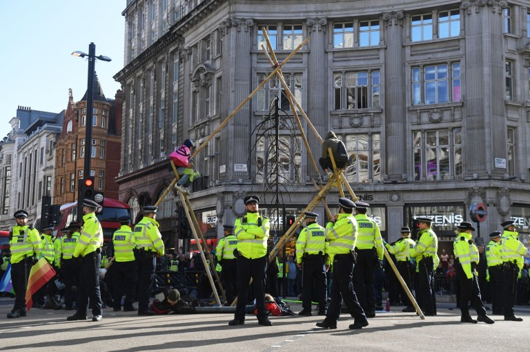 Protesters block the road at Oxford Circus, London, during an Extinction Rebellion (XR) climate change protesT