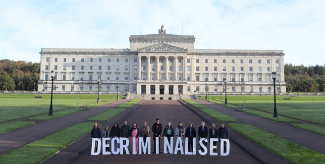 Pro Choice activists take part in a photocall in the grounds of Stormont Parliament, Belfast