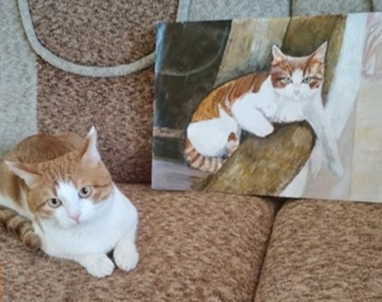 Cat next to cat painting