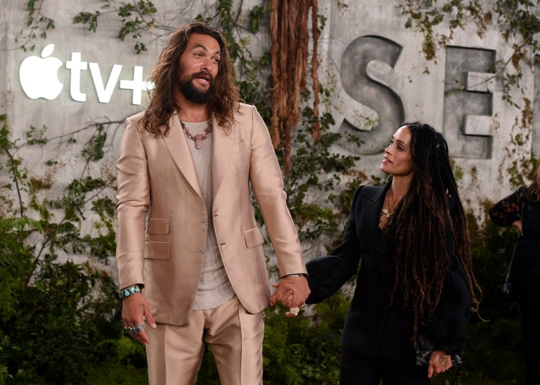 "Jason Momoa, left, a cast member in the Apple TV+ series ""See,"" arrives with his wife Lisa Bonet at the premiere at the Regency Village Theatre, Monday, Oct. 21, 2019, in Los Angeles. (Photo by Chris Pizzello/Invision/AP)"