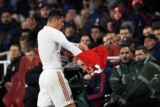 Granit Xhaka throws his shirt off as he subbed off playing for Arsenal