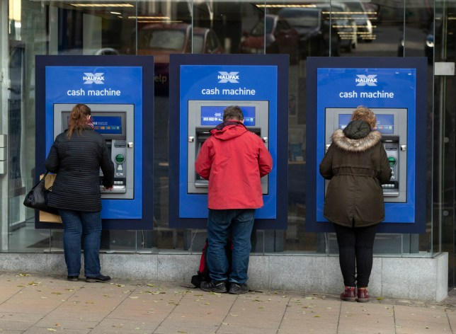 People using cash machines in Halifax in Yorkshire