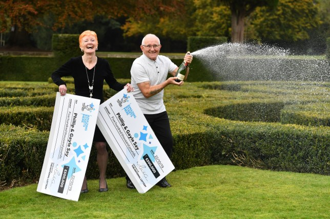 Gayle Say, 65, and her husband Phillip Say, 65, from Coventry, celebrating their Thunderball win at Coombe Abbey, Coventry. The couple won the top prize of ??500k twice in the same draw. PA Photo. Picture date: Thursday October 31,2019. See PA story LOTTERY Thunderball. Photo credit should read: Jacob King/PA Wire