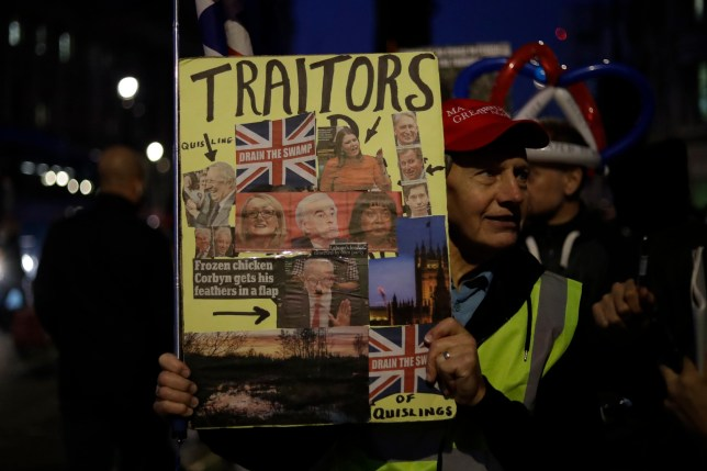 A pro-Brexit demonstrator protests during a rally outside the houses of Parliament in London, Thursday, Oct. 31, 2019. The EU has allowed Britain to delay its Brexit departure from the bloc until Jan. 31, enabling Britain to hold a general election on Dec. 12. (AP Photo/Matt Dunham)