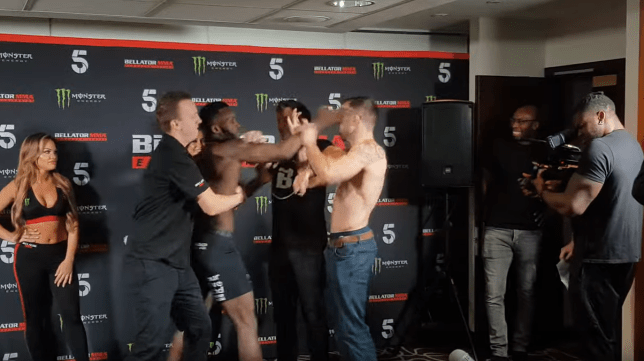 Fabian Edwards aims a slap at Mike Shipman during Bellator weigh-ins