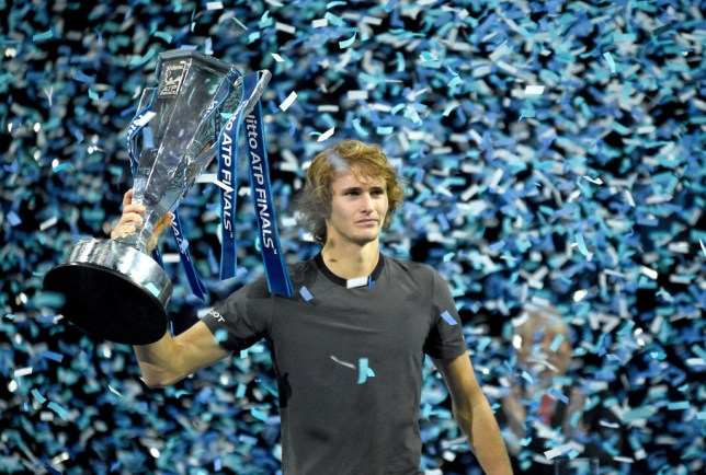 Alexander Zverev holds up the ATP Finals trophy after defeating Novak Djokovic in the final
