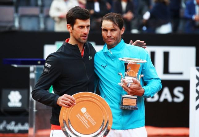 Novak Djokovic and Rafael Nadal embrace each other after a match