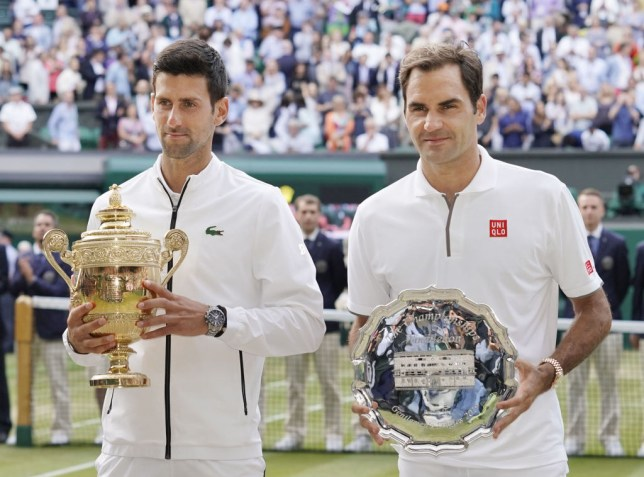 Novak Djokovic and Roger Federer stand side by side after their epic Wimbledon final