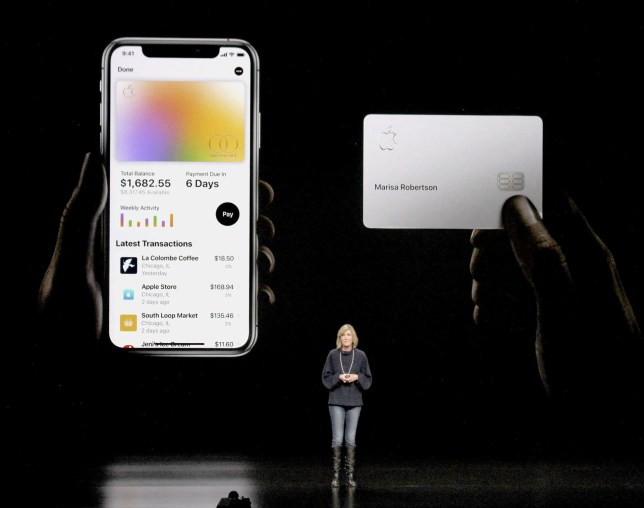 An Apple employee on stage at the March conference with the Apple Card functions on display in the background
