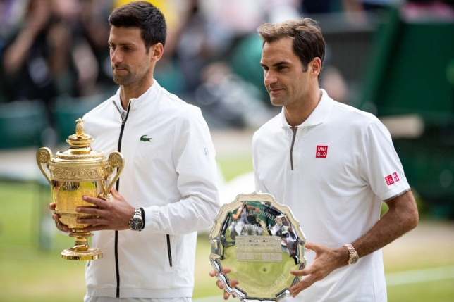 Novak Djokovic and Roger Federer stand side by side after the Wimbledon final