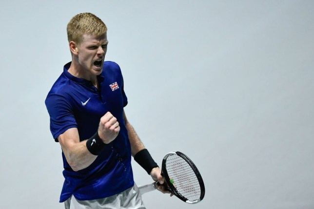 Kyle Edmund celebrates getting a win for Great Britain against Kazakhstan in the Davis Cup