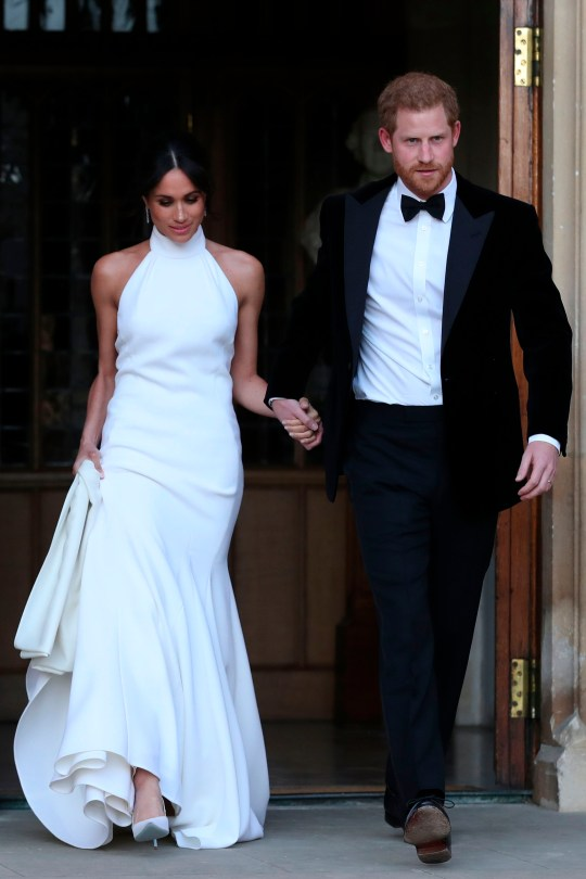 The Duke and Duchess of Sussex, Prince Harry and Meghan Markle on their wedding day at Frogmore House, headed for the reception. Meghan is wearing a Stella McCartney gown