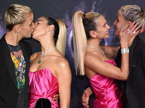 Dua Lipa and Anwar Hadid passionately kiss at American Music Awards during red carpet debut