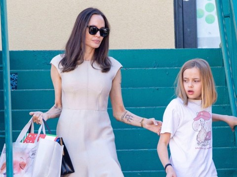 Angelina Jolie looks as though she's started Christmas shopping with youngest daughter Vivienne