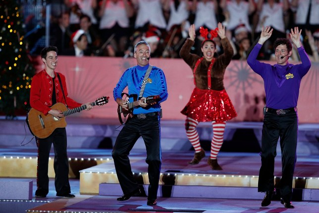 SYDNEY, AUSTRALIA - DECEMBER 17: The Wiggles perform during Woolworths Carols in the Domain on December 17, 2017 in Sydney, Australia. Woolworths Carols in the Domain is Australia's largest Christmas concert featuring some of Australia and the world's best-loved artists performing Christmas songs and carols. (Photo by Zak Kaczmarek/Getty Images for Active TV)