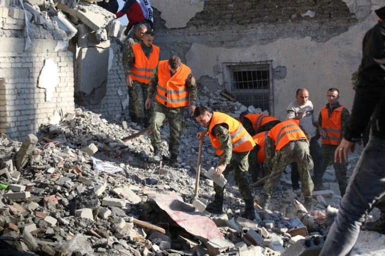 DURRES, ALBANIA - NOVEMBER 26: Soldiers and civilians conduct search and rescue operation at a damaged building after 6.4-magnitude earthquake hit Albania's Durres city on November 26, 2019. (Photo by Olsi Shehu/Anadolu Agency via Getty Images)