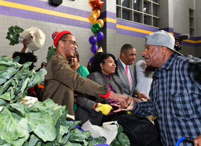 ATLANTA, GEORGIA - NOVEMBER 26: T.I. greets attendee at his annual Thanksgiving Turkey Giveaway at C.T. Martin Natatorium and Recreation Center on November 26, 2019 in Atlanta, Georgia. (Photo by Paras Griffin/Getty Images)